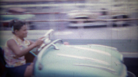 1965: Retro style bumper cars pulling out into the melee carnage crash area. SAN Footage