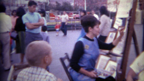 1965: Man Gets Caricature Drawing Done By Carnival Circus Lady Amauter Artist. S stock footage