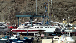 Spain Gran Canary Mogán 026 boatyard in front of rock face Footage