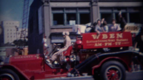 1964: WBEN evening news truck at parade Footage