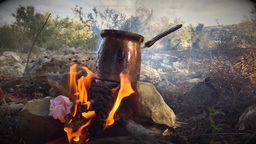 Making coffee with bonfire in the woods Footage