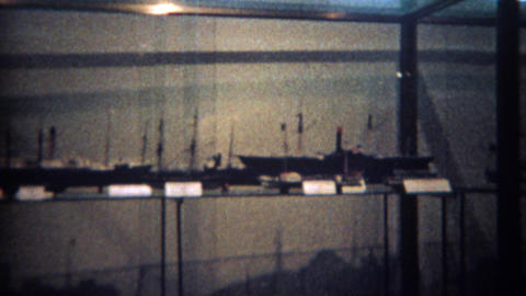 1965: Model boat museum in glass display cases Footage