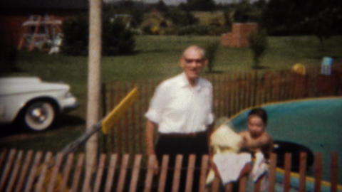 1964: Grandpa arrives in new white sports car to pool party Footage