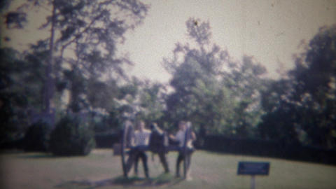 1961: Men climbing on historic civil war cannons like children Footage