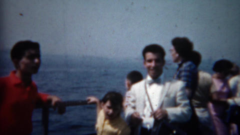 1961: Cool guy immigrant in white suit on boat coming to America Footage
