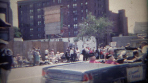1962: Parade interrupted by governor's car special request Footage