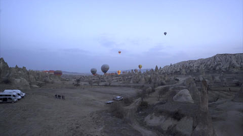 Aerial view of Goreme - Colorful hot air balloons flying over the valleys
