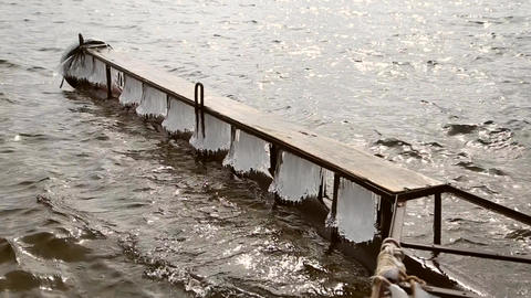 Icy pier on the river in the spring GIF