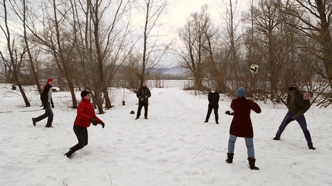 People play volleyball in the snow GIF