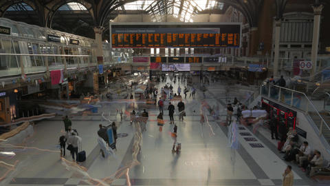 Timelapse shot in Liverpool Street station in London, UK with trail effects Footage