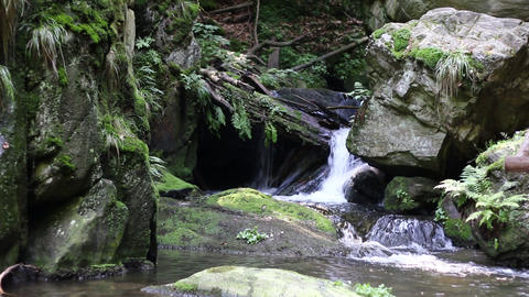 Water flowing between boulders Footage