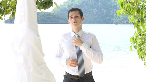 Groom in Black Trousers Sets Necktie Straight Live Action