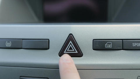 Man presses the alarm button in his car. The alarm must be turned on roadside tr Footage