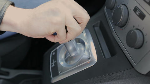 The driver shifts gears on an automatic transmission Footage