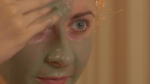 4K Ungraded: Girl Applies Face Mask While Looking in Mirror Footage
