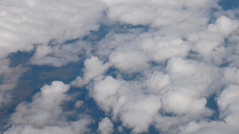 Clouds puffy fluffy sky aerial plane drone view on land earth ground Footage