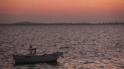 A boat in the golden evening Footage