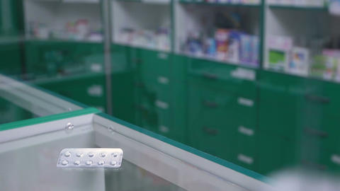 Close-up of pills in blister pack lying on counter Footage