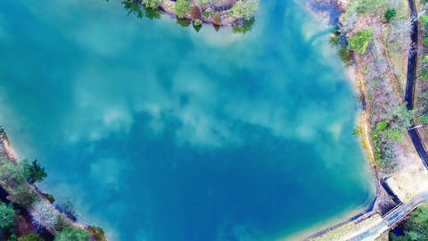 Zoom out from pond, video from the sky Footage