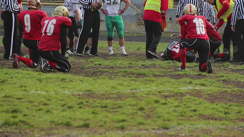 Sports medicine doctors rushing to provide injured player with urgent first aid Footage