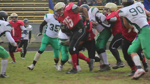 Active attack on gridiron field to tackle ball carrier, important football match Footage