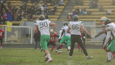 Gridiron football player making forward pass towards defensive team's goal line Live Action