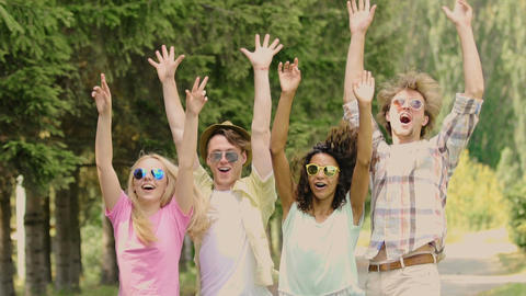 Cheerful friends dancing, waving hands, smiling and enjoying life at party Footage