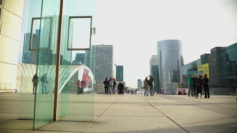 Tourists photographing modern architecture in Paris, city sightseeing tour Footage