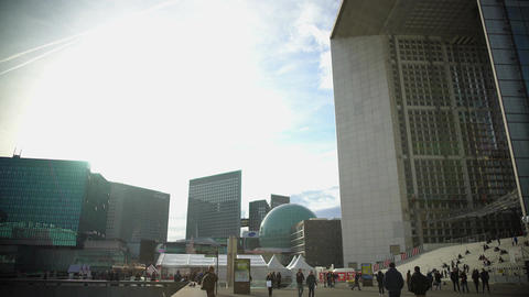 Tourists walking near beautiful monument Grande Arche de la Defense in Paris Footage