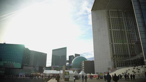 Tourists walking near beautiful monument Grande Arche de la Defense in Paris Live Action