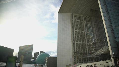 View on Grande Arche de la Defense and modern glass buildings in Paris, France Footage