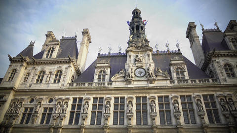 Panorama of Hotel de Ville in Paris, antique architecture and flags on building Footage