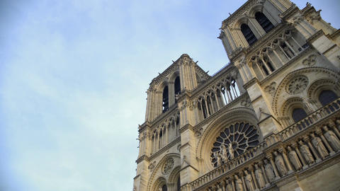 Amazing French Gothic architecture of Notre-Dame de Paris, bottom view panorama Footage