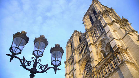 Antique streetlight and Notre-Dame cathedral, sightseeing in Paris, France Footage