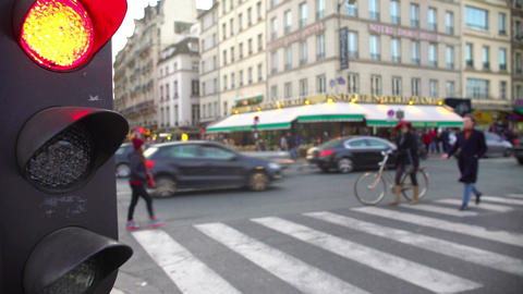 Red light for street traffic, pedestrians crossing road, active city life Footage