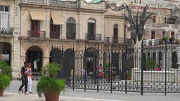 Tilt down and pan to the Old Plaza in Old Havana, Cuba Footage