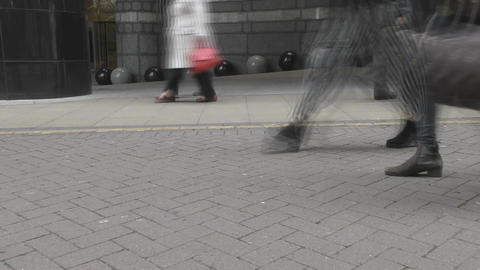 Time lapse. Pedestrians walk along the sidewalk Footage