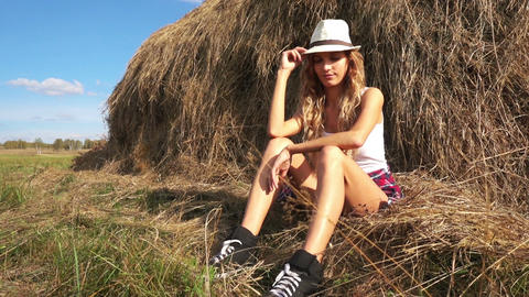 Young Woman Resting Near Haystack Footage