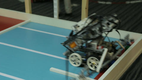 Mechanic Toy Robot Moves and Turns on Platform Footage