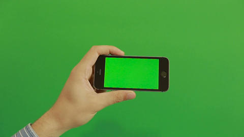 Smartphone tap hand gestures on green screen.horizontal Live Action