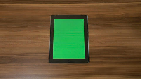 Man Hand Using Vertical Digital Tablet with Green Zoom Out on the Background of  Footage