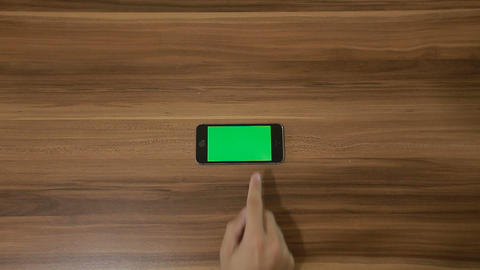 Smartphone Swipe left hand gesture on the Background of Wooden Table.Horizontal Footage