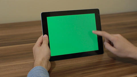 Man Using Horizontal Digital Tablet swipe up hand gestures with Green Screen on  Footage