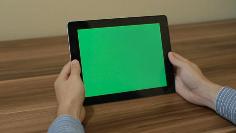 Man Using Horizontal Digital Tablet tap hand gestures with Green Screen on the B