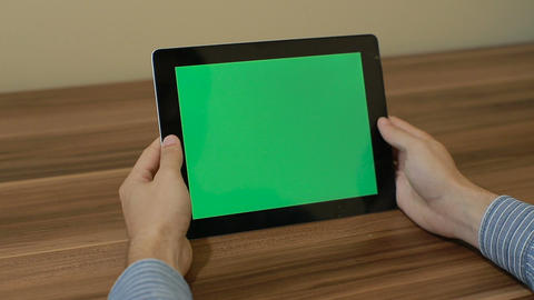 Man Using Horizontal Digital Tablet swipe left hand gestures with Green Screen o