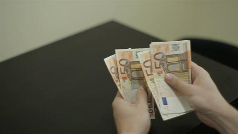 View of a woman Counting Many Euro 50 bills Footage