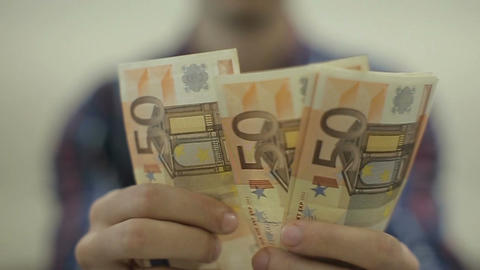 View of a man Counting Many American Euro 100 bills, Man not happy about not hav Footage