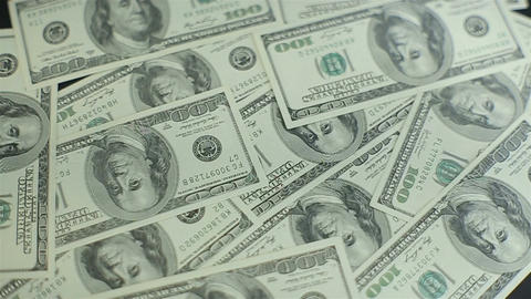 One hundred american dollar bills falling through air.Slowmotion Footage
