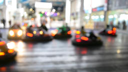 Blurred motion of people driving bumper cars Footage
