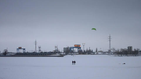 Family using a kite on frozen water storage reservoir Footage